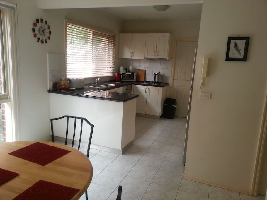 Modern open kitchen and dining area. Opens to a cute courtyard with BBQ.  Has dishwasher, microwave, wall over and large fridge.  Coffee machine! Rice Cooker!