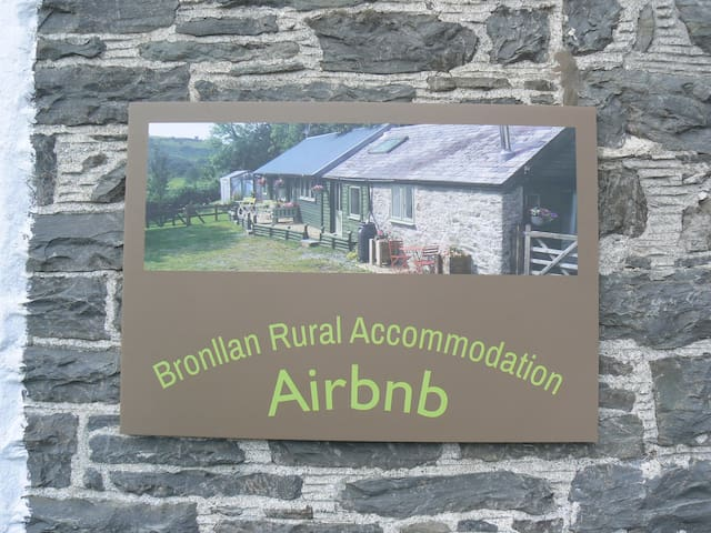 You will see this sign on the front of the main house if you are coming from the Tregaron/Pontryhdfendigaid direction. The listings are at the rear of the house and the gate is on the right of the house as you look at it.