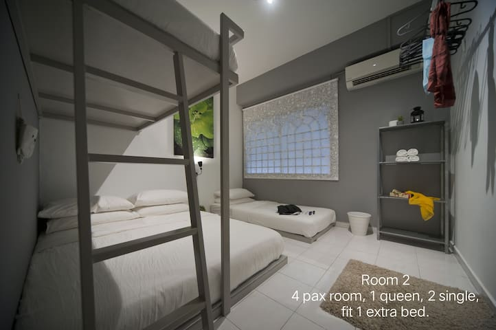 4 pax room (room 2) 1 queen, 1 single, 1 single bunk bed can add 1 extra bed