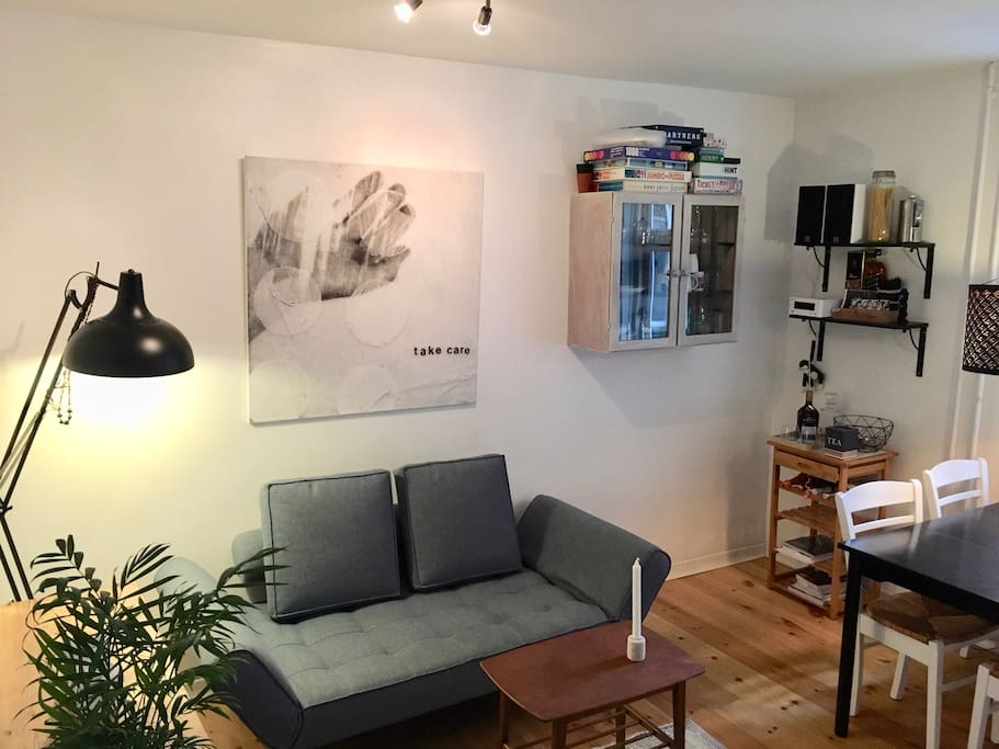 Living room, containing stereo, television and PS4