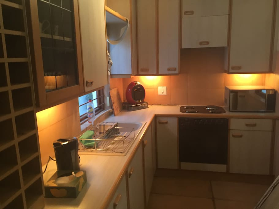 Fully equipped kitchen including a microwave and coffee machine