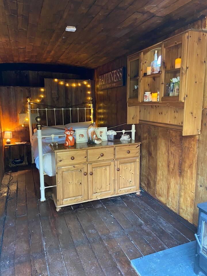 Converted horse box, and bathroom  in pub garden