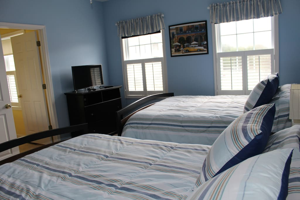 Two full size beds with full bath