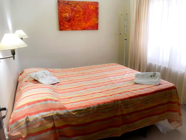 The double bed can accomodate two adults comfortably.