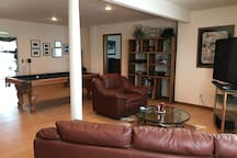 Pool table, living area with big screen television.  Access to 115 channels via Directv