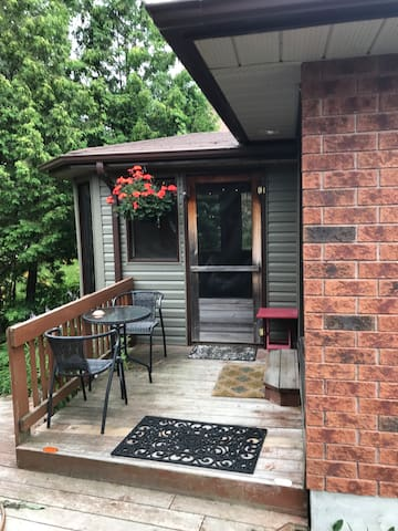 Small deck and gazebo outside of apartment.