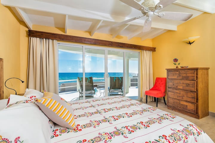 Your stunning ocean view bedroom has a king size memory foam bed, premium bedding, an ensuite bathroom and sliding glass doors that lead to the upper terrace.