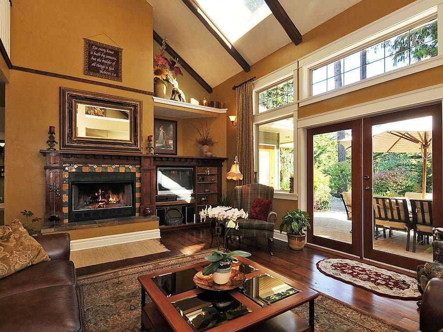 Wood burning fireplace and walk out french doors to serene patio