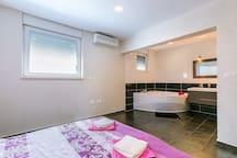 Bedroom 3 with open bathroom