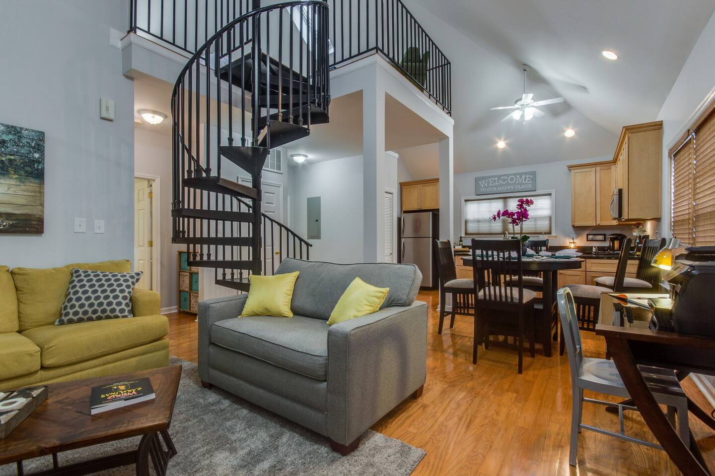 Spacious open living room with beautiful spiral staircase!