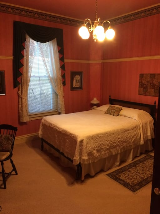 Room with antique bed, dresser & desk plus small sofa