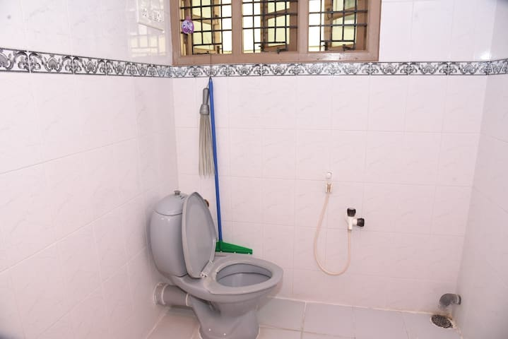 Bathroom View #2 (Western toilet & shower facility with toiletries provided)