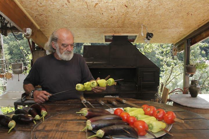 Host of Daravand Guest House, Razmik is making BBQ