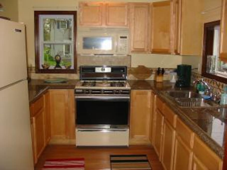 Granite-counter  kitchen fully supplied with cookware, blender, microwave, coffee.