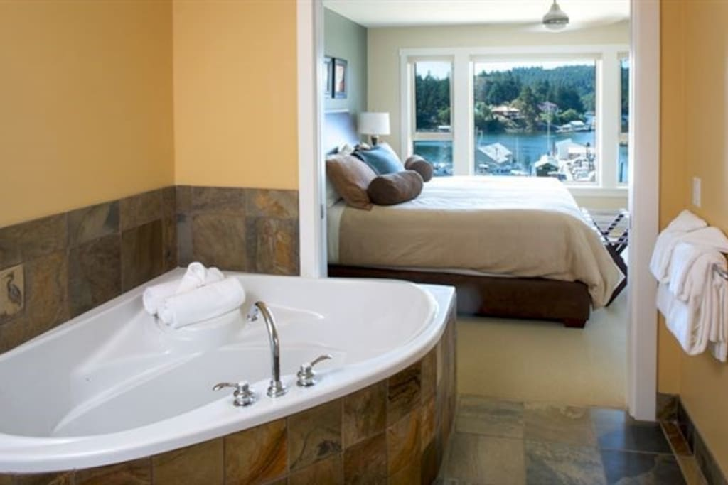 Relax in the tub in the pristine bathroom.