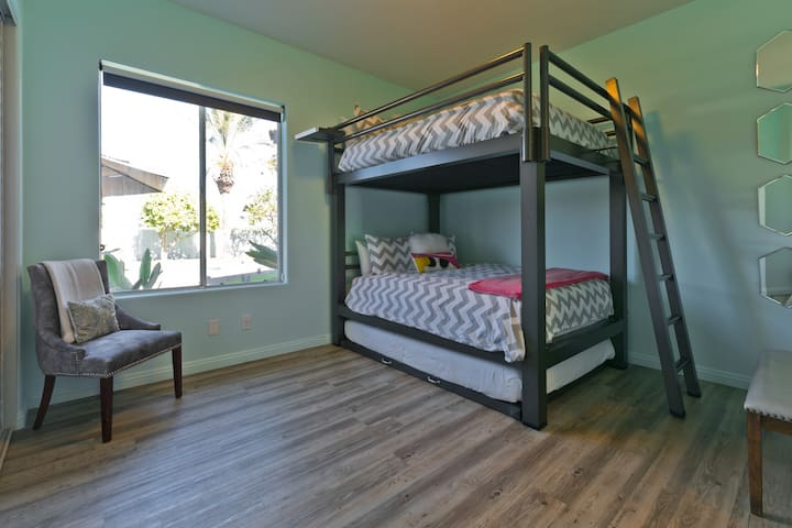 (Bedroom #2) Secondary bedroom with queen bunk beds and queen pull-out queen trundle.