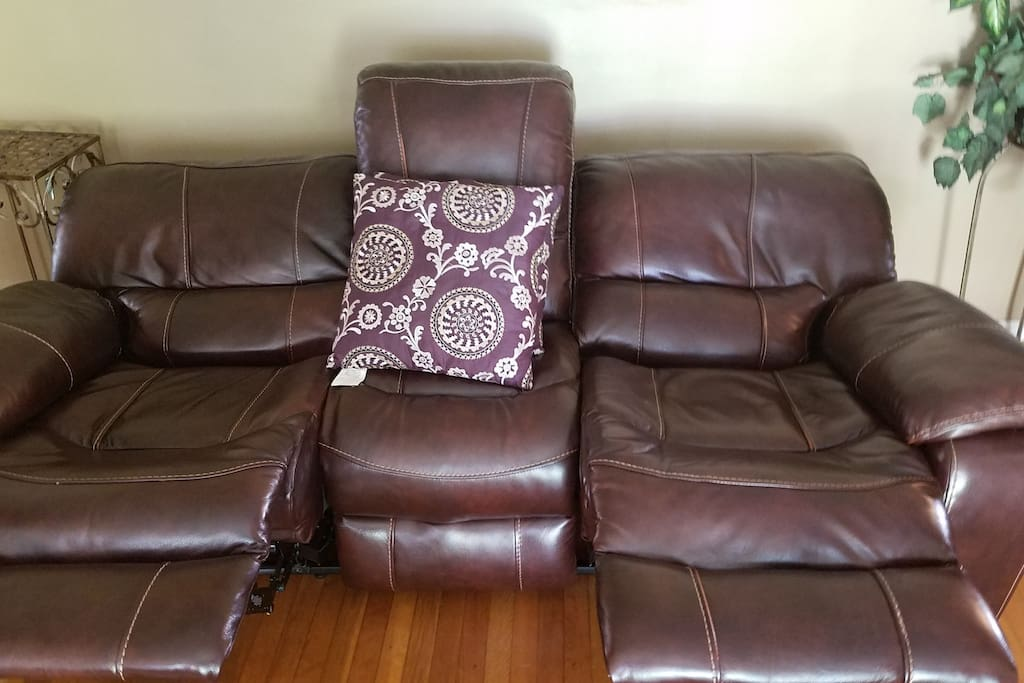 Leather Sofa reclines flat -- Additional Sleeping space