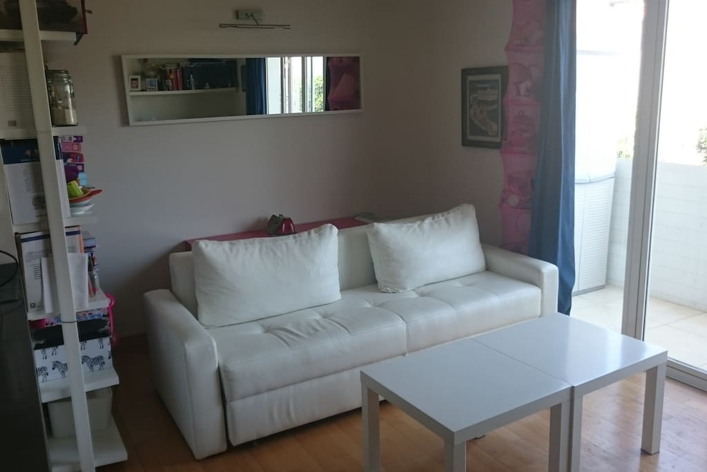 The living area has a double sofa bed, tv, wifi internet and a balcony with table and chairs.