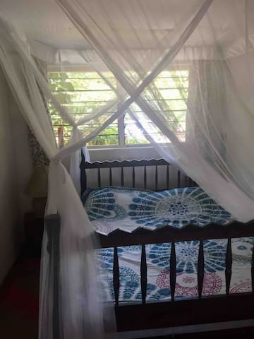 Small room downstairs with queen bed