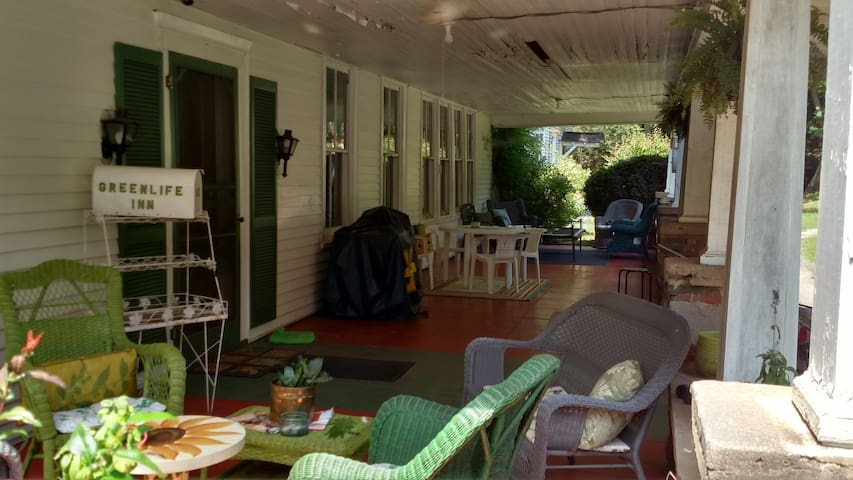Our covered porch is perfect for a bit of conversation; especially when the sun or rain is beating down.