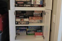 Play a game or put together a puzzle from the games cabinet