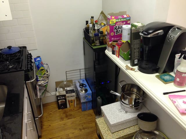 In the kitchen, there is a coffee machine, wine cellar, oven, dishwasher and fridge.