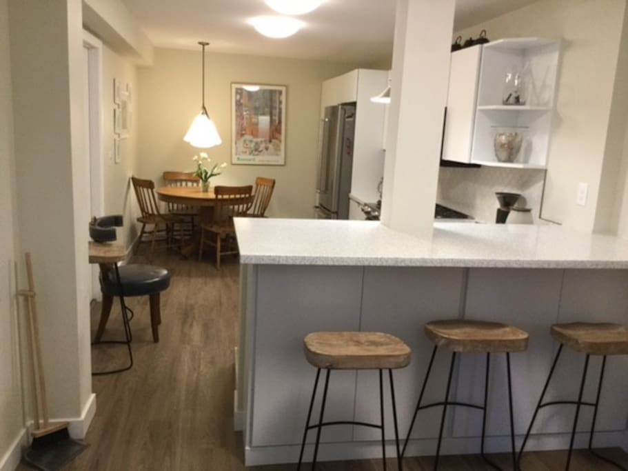 Fully furnished kitchen with extra seating at the bar.