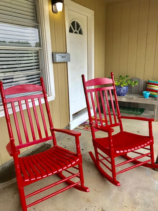 Nothing quite compares to Porch Time in Texas, complete with two red rocking chairs and a bench greet guests, enjoying morning coffee, watching storms roll in, or long conversations-