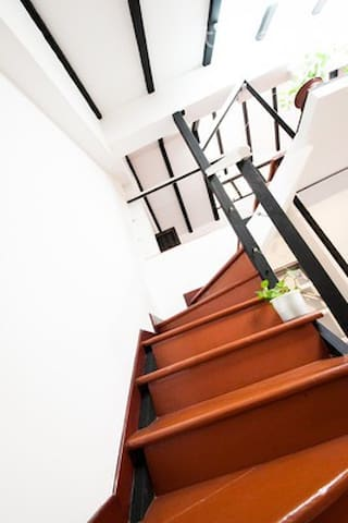 Loft stairs to loft. Viewed from dining table.