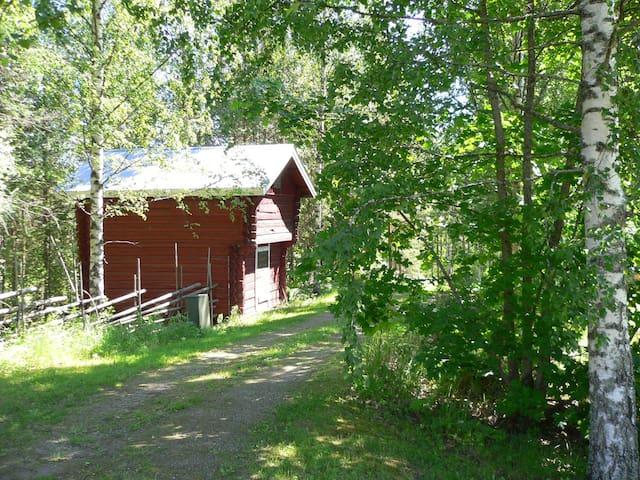 Old rustic granary on a farm next to a lake, B&B