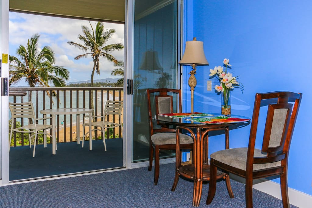 Dining area inside and out with view of Wailua Bay.