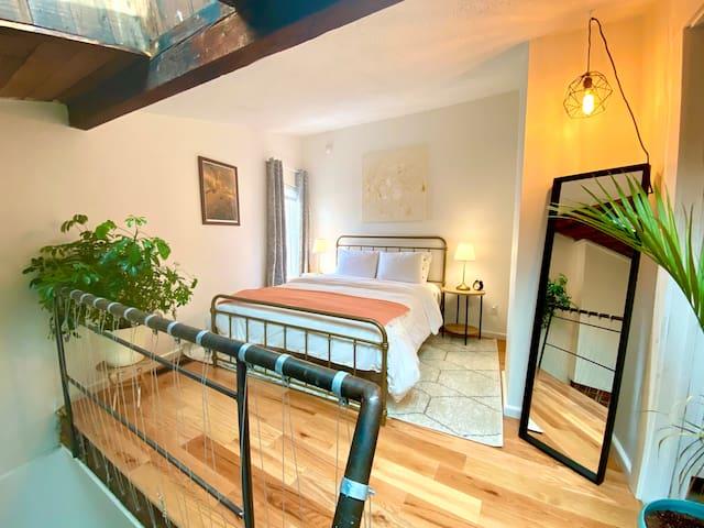 Loft bedroom with skylights