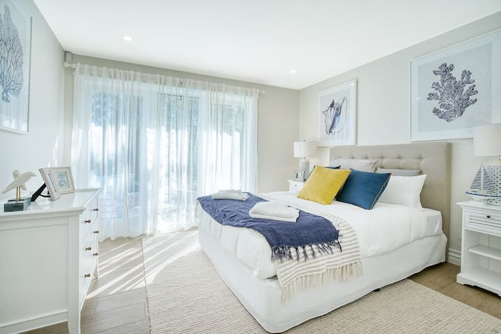 Downstairs, the queen-sized bedroom is dressed in hotel-quality linens to ensure a good night's sleep. There is ample storage space for your belongings.