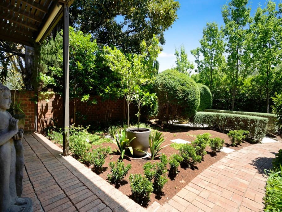 Front garden is a beautifully manicured oasis, relax with the newspaper and enjoy this view from the master bedroom. Secured with a high fence children can play safely in the front yard as well as providing off street parking for one car.