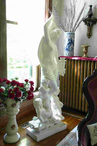 Hand carved marble statuary. Just 1 of many pieces of fine art that graces this incredible property.
