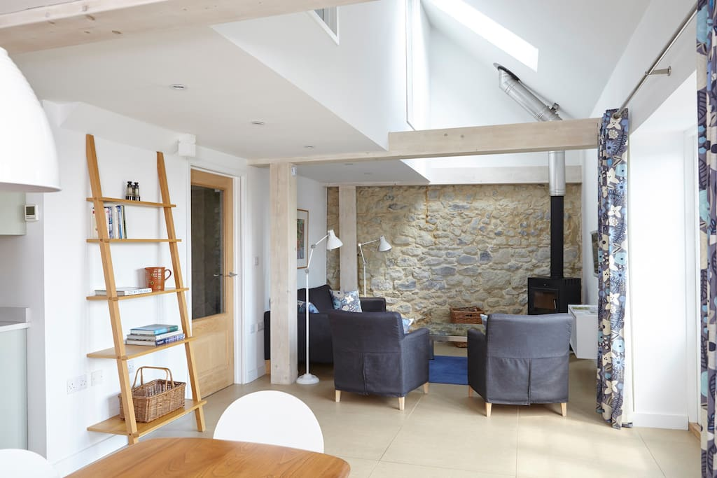Contemporary Living in this very old barn, the exposed stone wall is 400 years old! Scandi wood burner, Underfloor heating