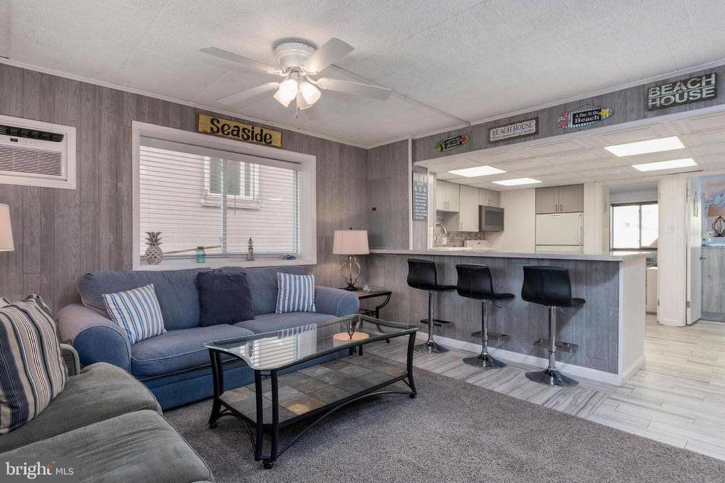 Plenty of seating in the all new family room. Two large windows can be opened for great ocean breezes. The sleep sofa is queen sized. The kitchen is fully stocked and has new appliances.