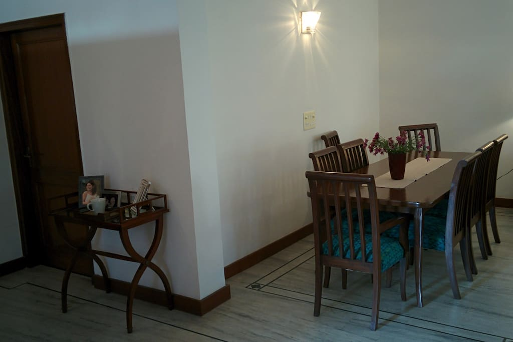 The entrance to the apartment and the dining area