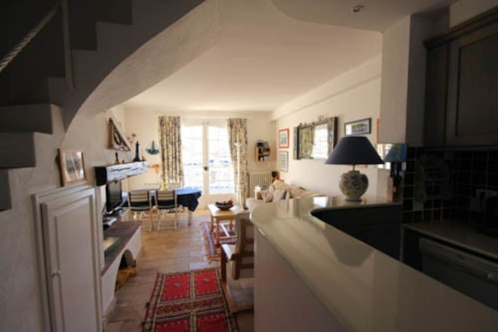 Spacious living room and kitchen with doors to private terrace