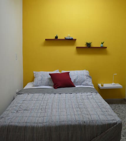 Room # 8 Counts with a set of comfortable and clean sheets, double-size bed,private bathroom with hot water,one night stand , fan,closet  and mirror.  This room is located inside the garage in a kind of basement