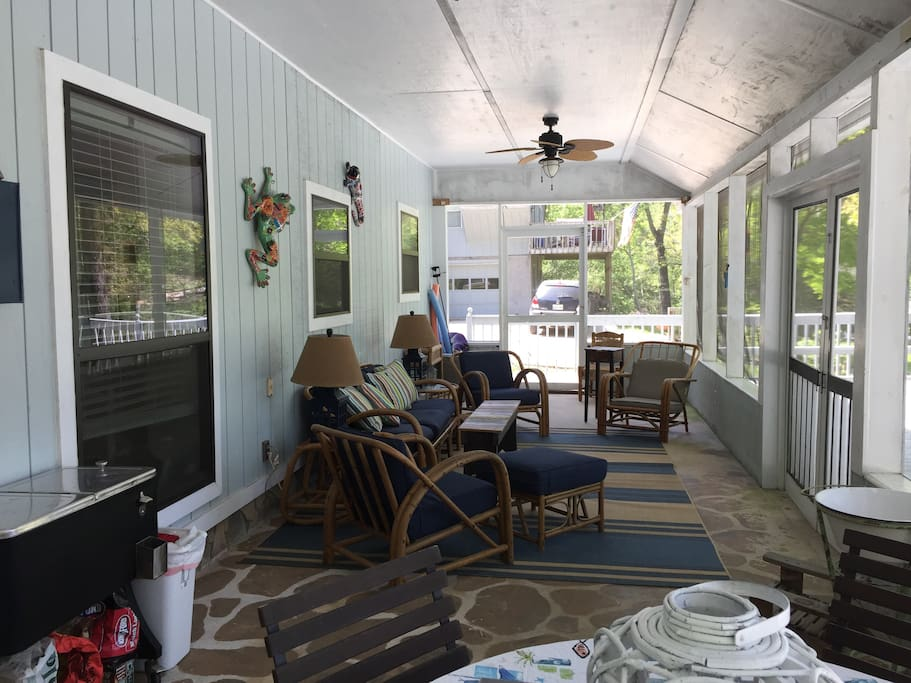 Huge screen porch with dining table and lounge seating!  Inclement weather, no problem, bring all the board games onto the porch!!