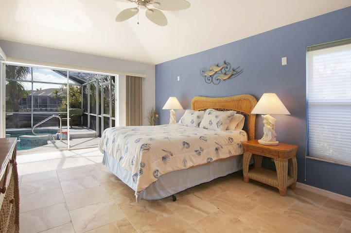 Master bedroom suite with 2 huge glass doors leading out to the pool