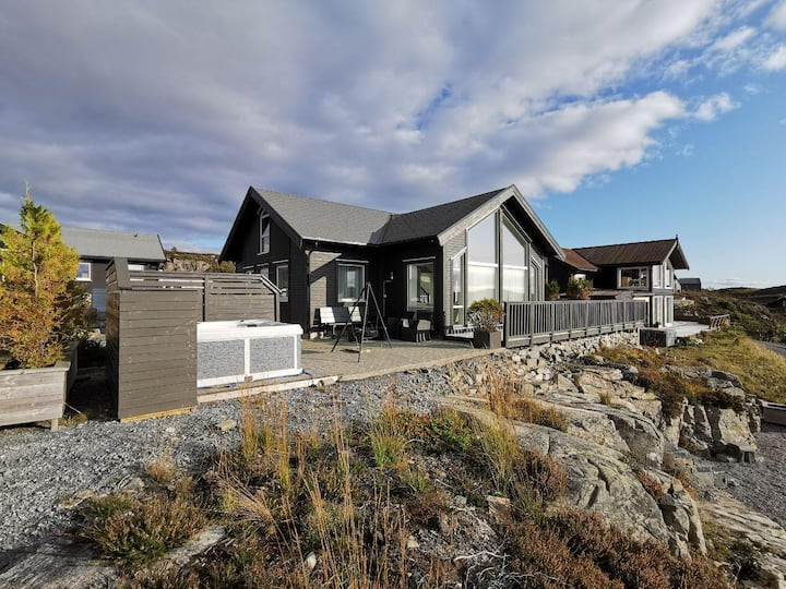 New cottage by the sea, with outside jacuzzi.