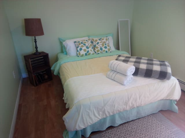 Relax on our new queen bed in a quiet bedroom facing the backyard.