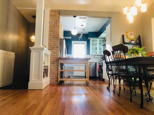 Dining room and kitchen. The gate to the left is the stairs to access the master bedroom downstairs. It can be locked to keep kiddos from tumbling downstairs!
