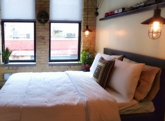 Cozy second bedroom with a queen-size bed and memory foam mattress