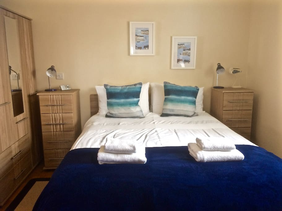 The apartment sleeps 4 people in two bedrooms . This is the Master bedroom with ensuite shower room  . It has a Kingsize bed, triple wardrobe ,dressing table/workspace ...