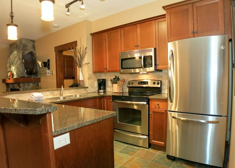 Stunning large kitchen with stainless steel appliances