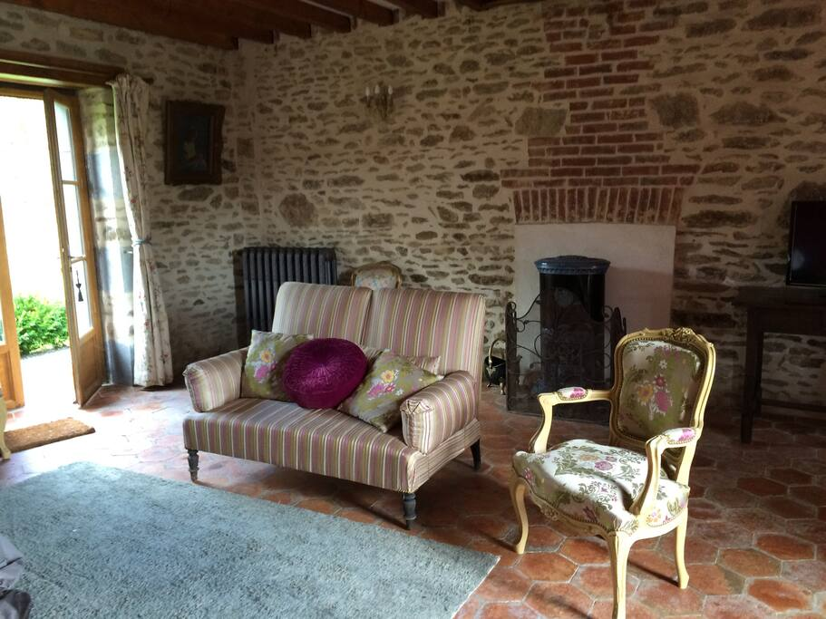 Sitting room, tastefully decorated with period furniture and with French doors to garden, wood burner and English TV.
