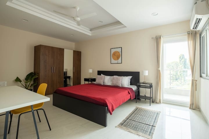 Master bedroom with attached bathroom and balcony